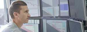 Person looking at a bank of trading screens