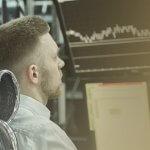 Professional Trader sitting at desk