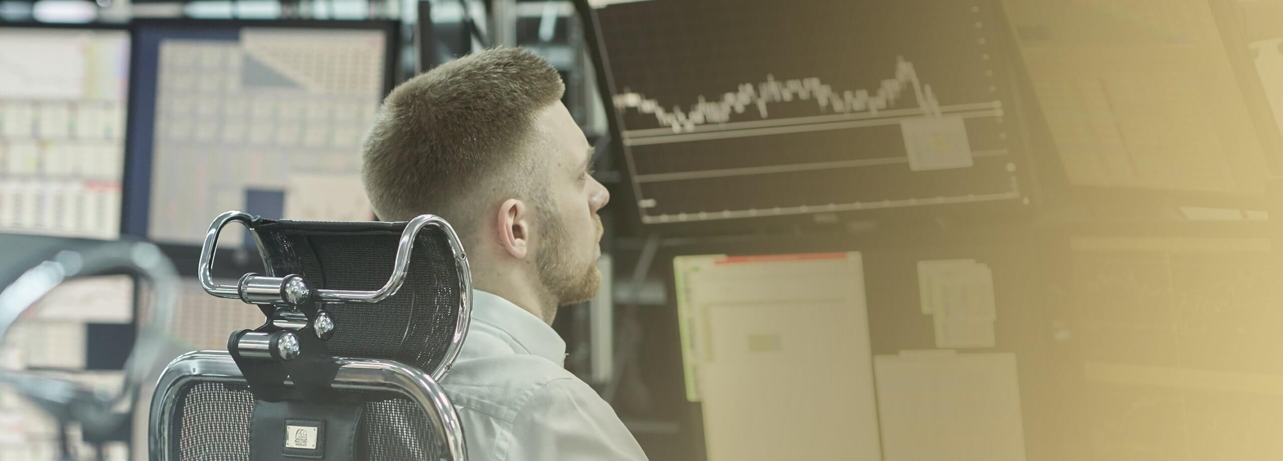 Professional Trader sitting at desk