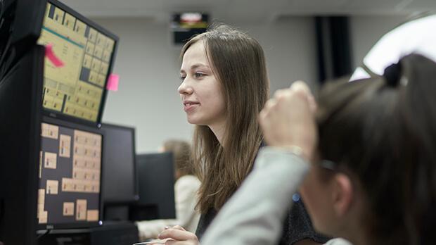 Woman at trading screens
