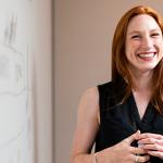 Smiling woman giving presentation