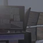 Trader looking at bank of screens