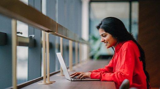 Woman working facing window