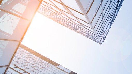 sunlight shining through glass buildings